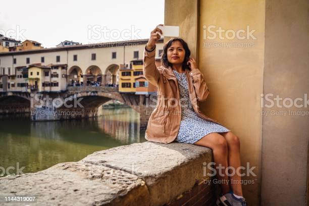 Young adult woman exploring florence in italy picture id1144319007?b=1&k=6&m=1144319007&s=612x612&h=qytxkiyc2de3u7kyb8h5bgwayqhxrfgppqx3yjsrohg=