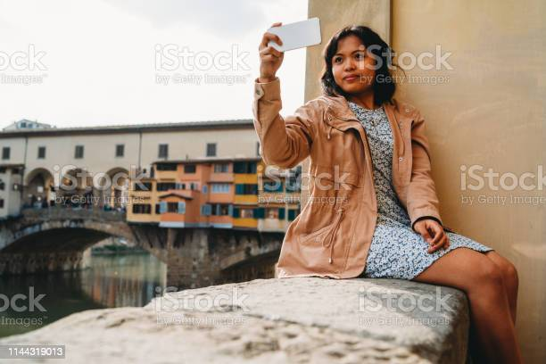 Young adult woman exploring florence in italy picture id1144319013?b=1&k=6&m=1144319013&s=612x612&h=mq4n5v9xwdyujomksd9zll7qpcj8mfh4wzjivwrn0bq=