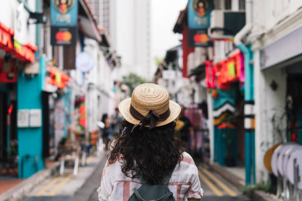 Young adult woman exploring Haji Lane street in Singapore stock photo