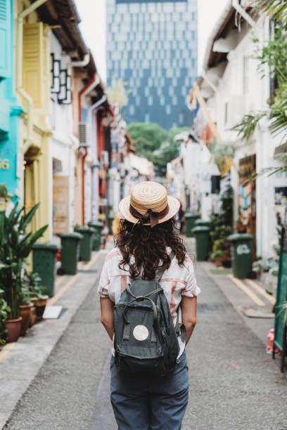 Young adult woman exploring Haji Lane street in Singapore stock photo