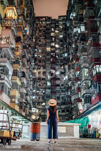 Young adult woman exploring Quarry Bay district in Hong Kong