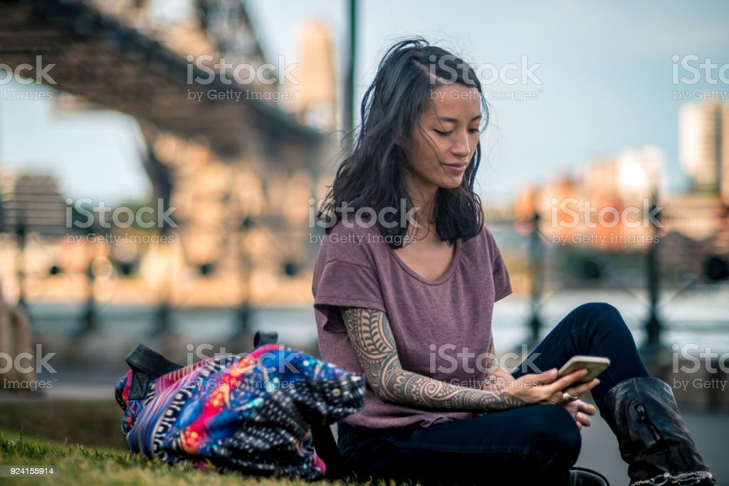 Young adult woman have a break and enjoying next to Sydney Harbour Bridge stock photo