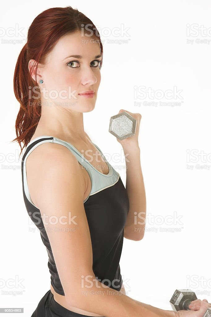 Young adult woman in gym training with weights royalty-free stock photo