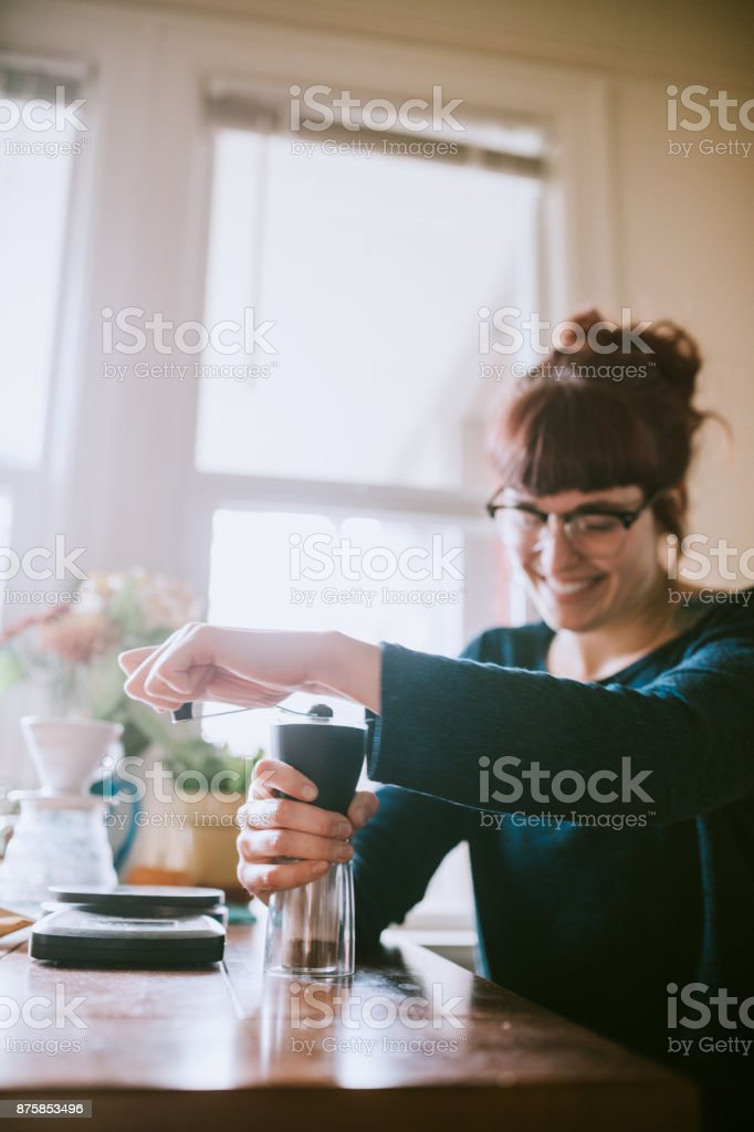 Young Adult Woman Making Coffee At Home stock photo