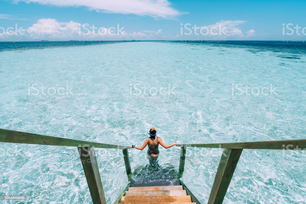 Young adult woman moving down to the sea stock photo