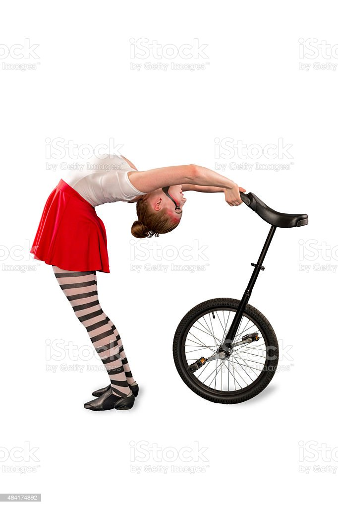Young Adult Woman Performing with Her Unicycle stock photo