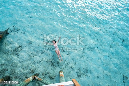 Young adult woman relaxing in the sea