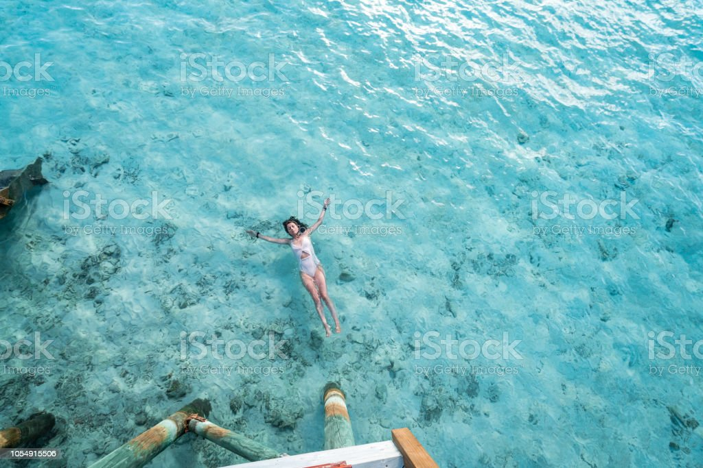 Young adult woman relaxing in the sea stock photo