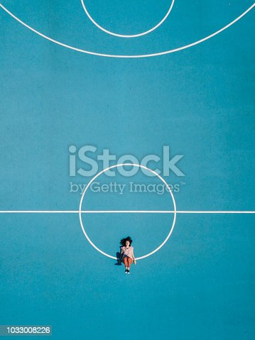 istock Young adult woman sitting on a surreal swing 1033008226