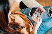 istock Young adult woman swiping on an online dating app 1271341235