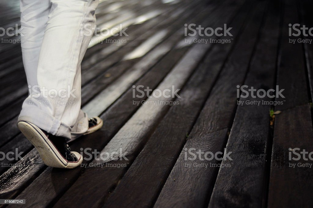 Young adult woman walking stock photo