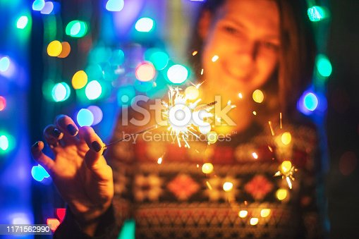 istock Young adult woman with bengal lights 1171562990