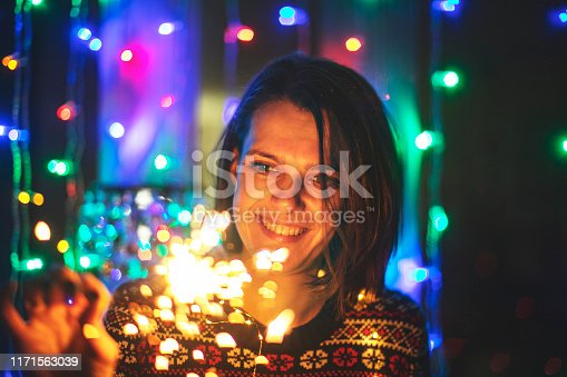 istock Young adult woman with bengal lights 1171563039