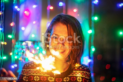istock Young adult woman with bengal lights 1171563044