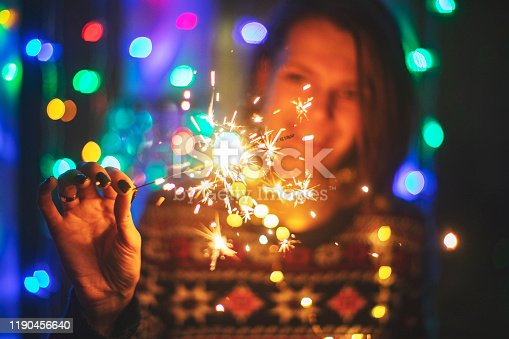 istock Young adult woman with bengal lights 1190456640