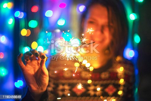 istock Young adult woman with bengal lights 1190456649