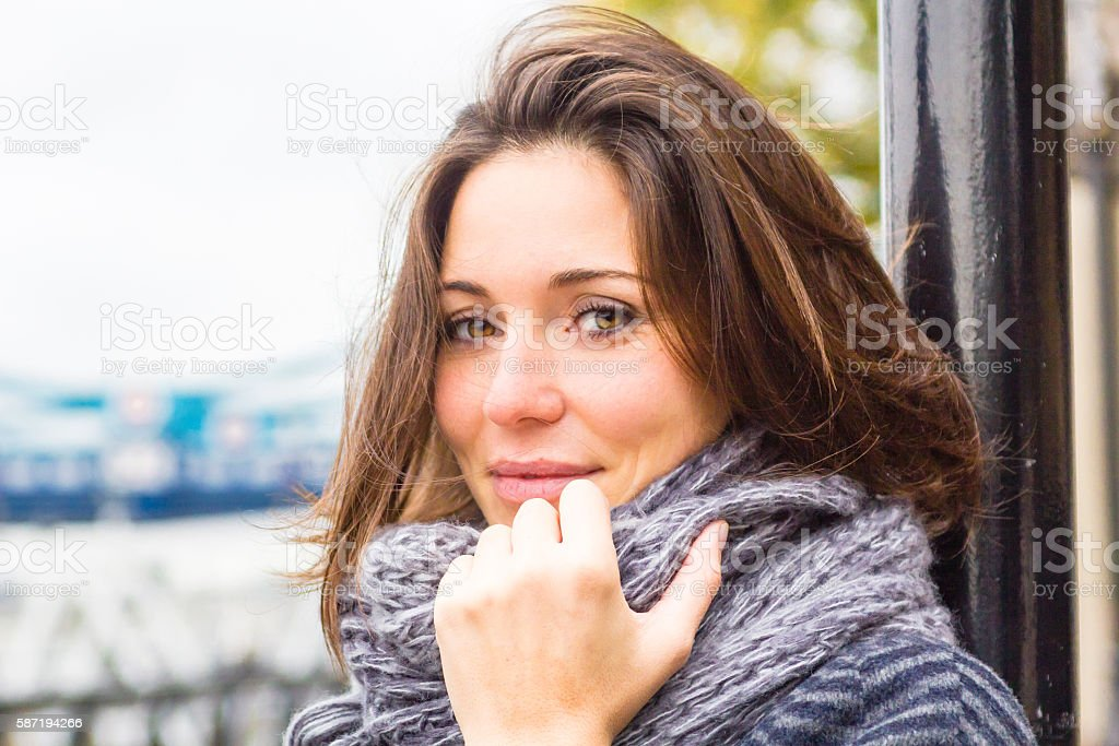 Young Adult woman with scarf in autumn London stock photo