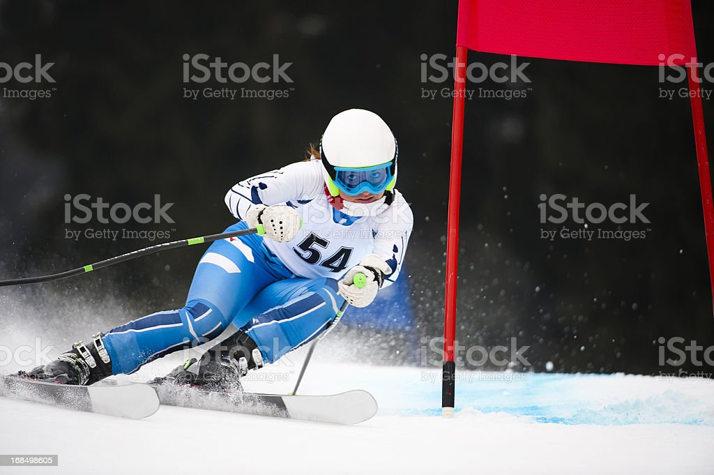 Young adult women at giant slalom race stock photo