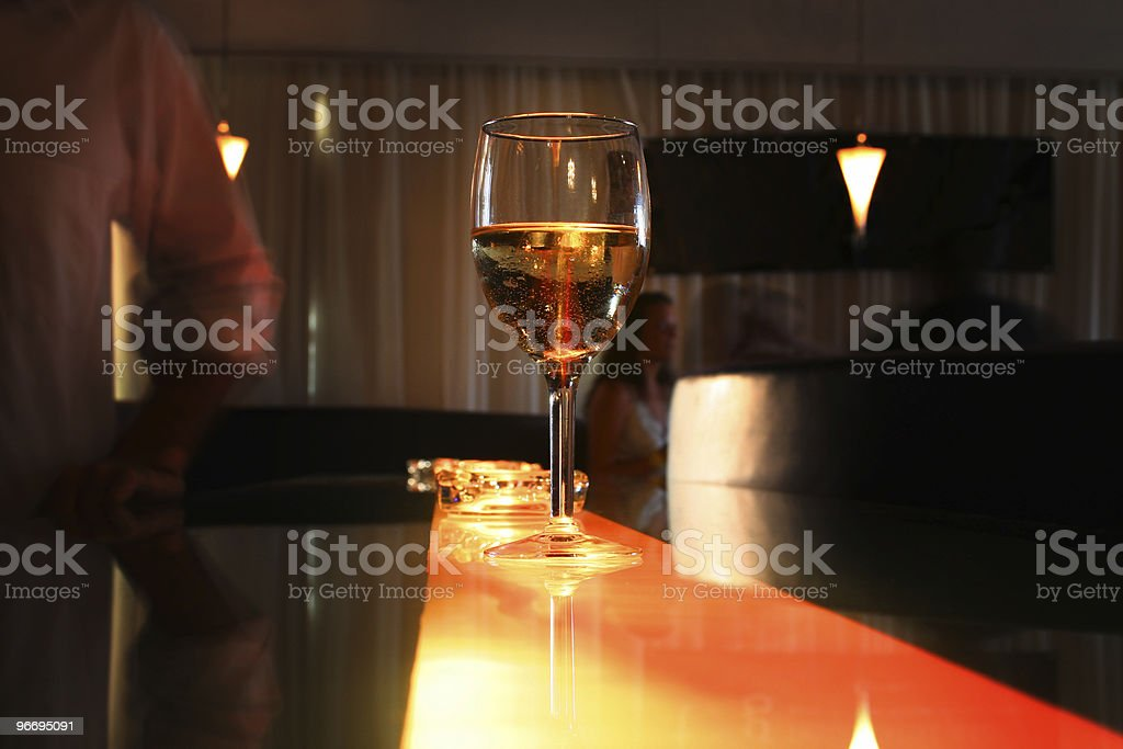 Young Adults at Club with Glass of Wine on Bar royalty-free stock photo