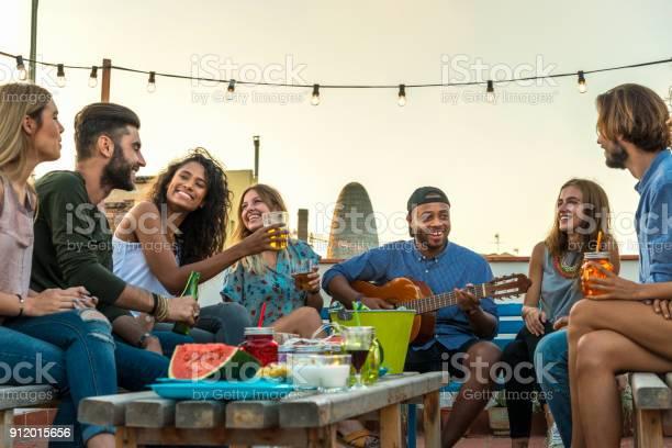 Young adults celebrating life and friendship on a rooftop in spain picture id912015656?b=1&k=6&m=912015656&s=612x612&h=s6qawyb0 gj3pc5zmsgb9g65xvdchskdasgndtqxip0=