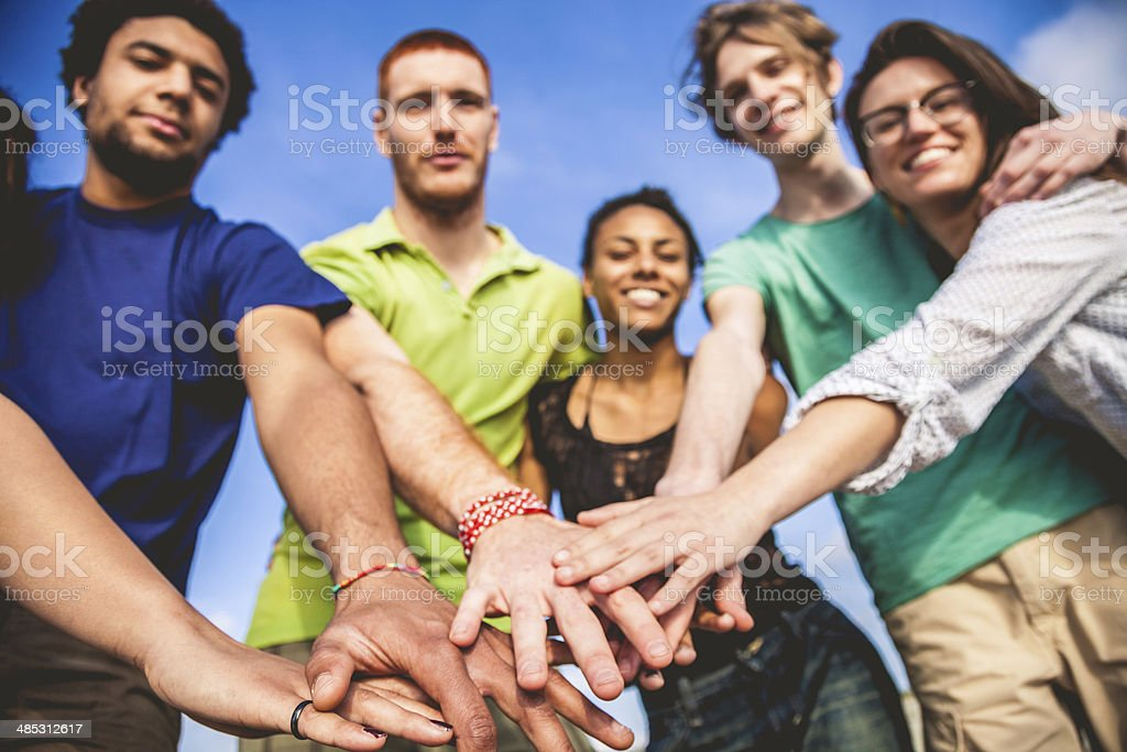 Young adults cooperating together royalty-free stock photo