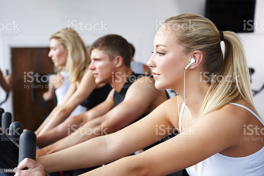 Young Adults Cycling on Stationary Bikes royalty-free stock photo