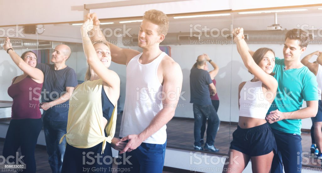 Young adults dancing bachata together in dance class stock photo