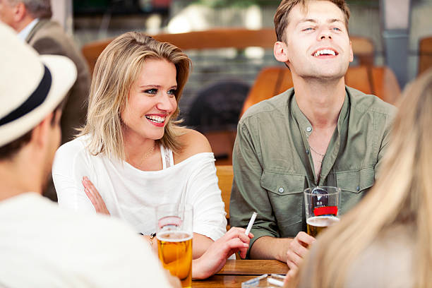 Young Adults Drinking Beer And Smoking stock photo