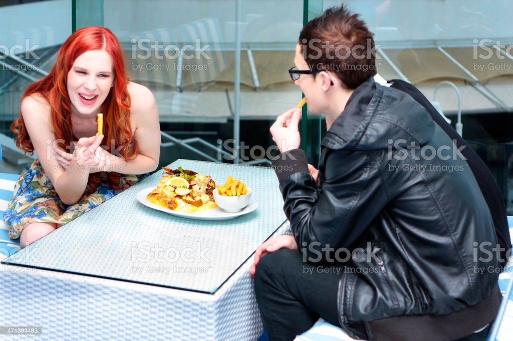 Young adults enjoying gourmet food royalty-free stock photo