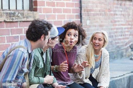 521022435istockphoto Young adults hanging out talking 531502645