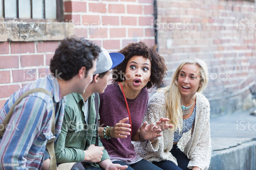 Young adults hanging out talking stock photo