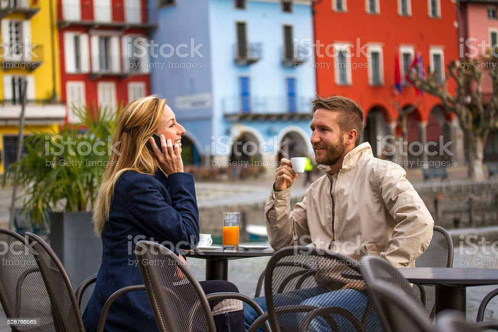 Young adults having a coffee break stock photo
