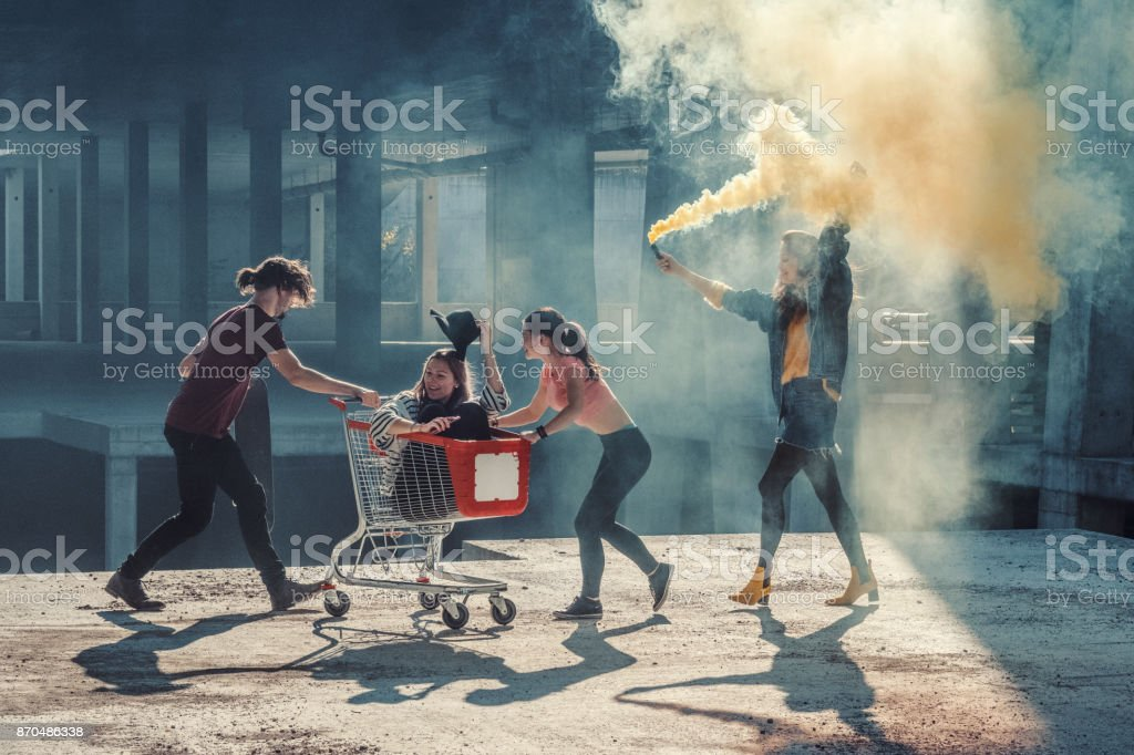 Young adults having fun at abandoned construction site stock photo