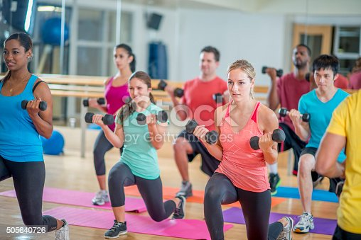 istock Young Adults in a Fitness Class 505640726