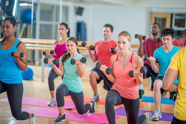 young adults in a fitness class - aerobics stock photos and pictures