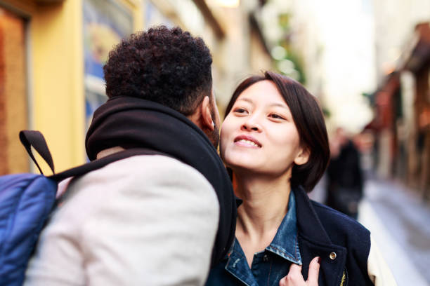 Young adults kissing in the streets of Paris stock photo