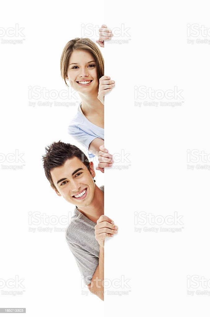 Young Adults Looking Around a Corner - Isolated stock photo