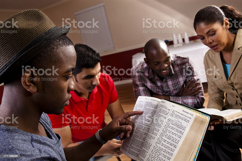 Young adults, multi-ethnic group in a Bible study at church. stock photo