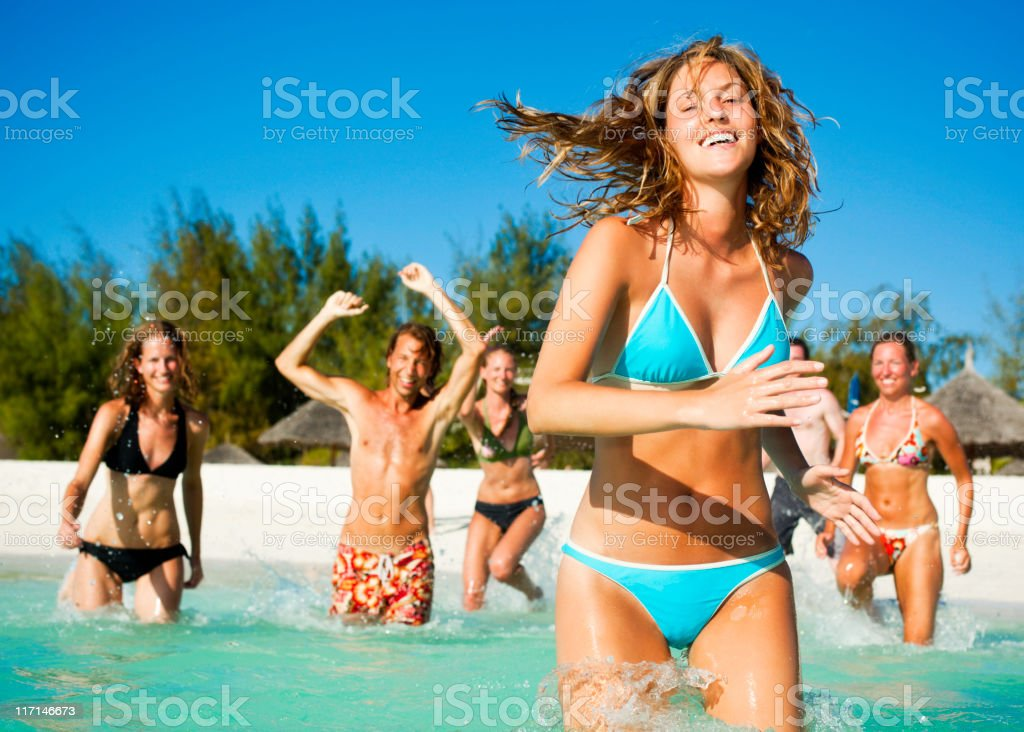 Young Adults on a Tropical Beach royalty-free stock photo