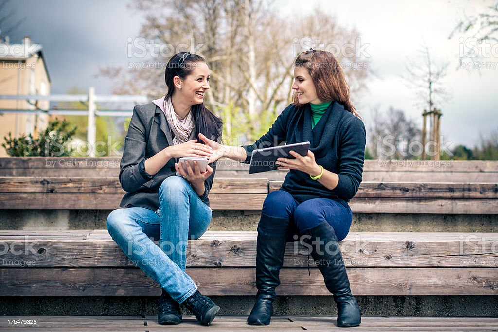 Young adults online with digital tablets stock photo