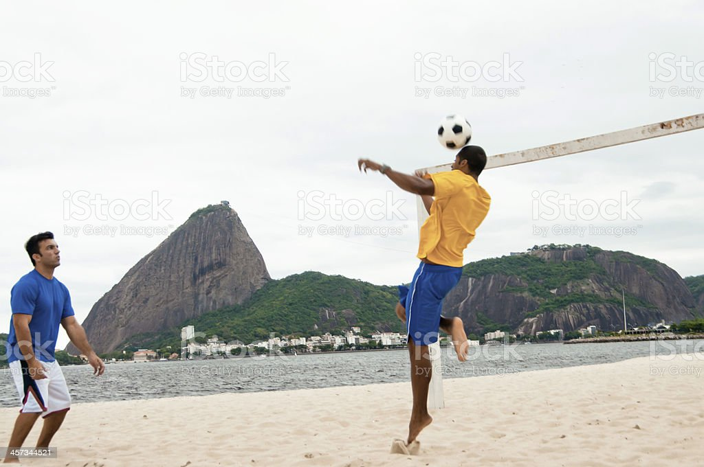 Young Adults Playing Football on Praia do Flamengo Beach stock photo