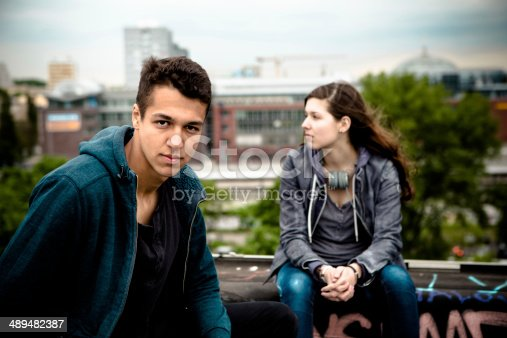 521022435istockphoto young adults portrait on urban background 489482387