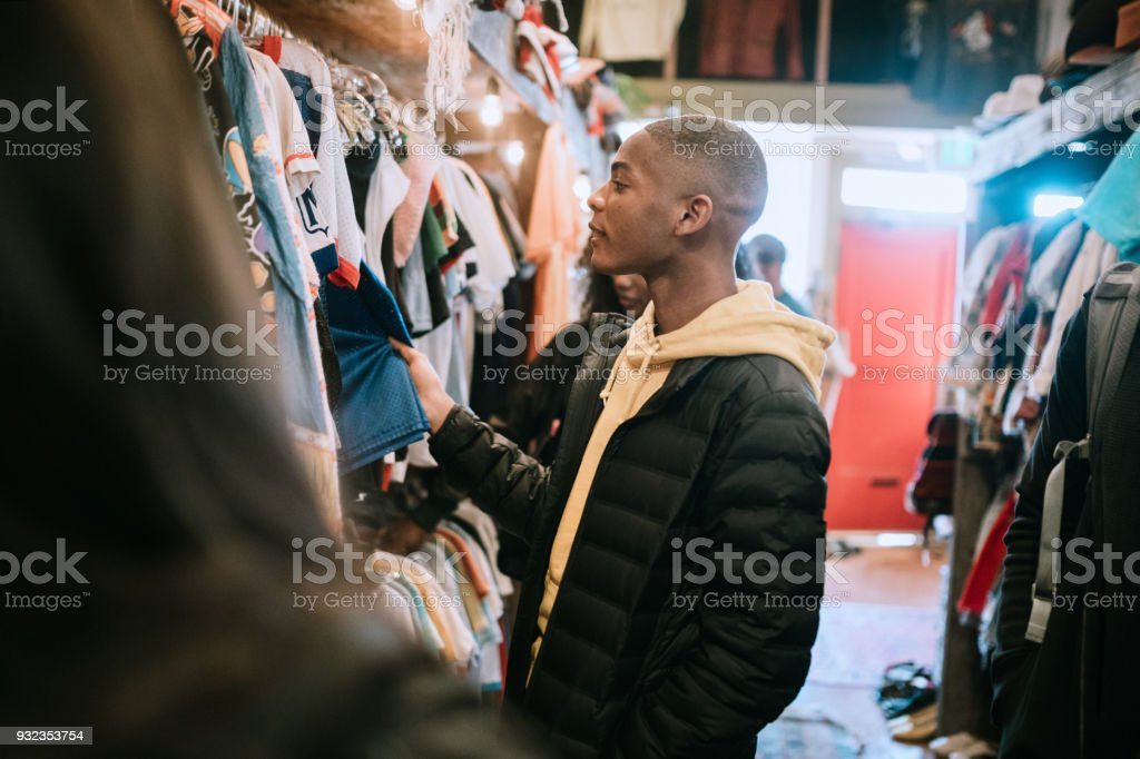 Young Adults Shop For Clothes at Thrift Store stock photo
