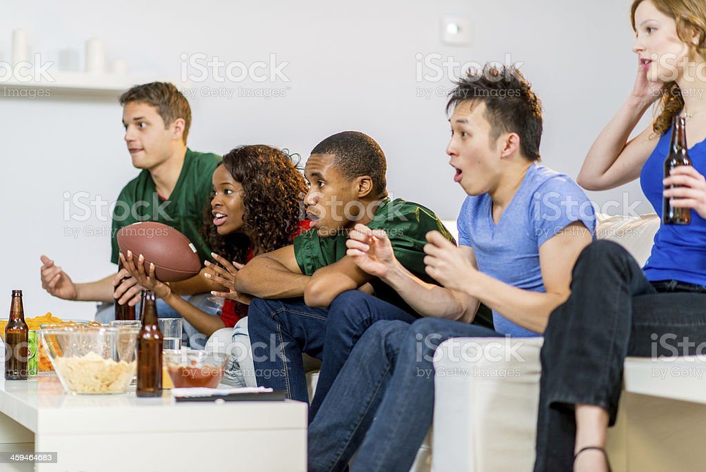 Young adults watching football royalty-free stock photo