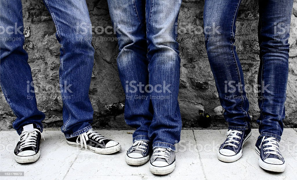 young adults wearing denim and sneakers stock photo