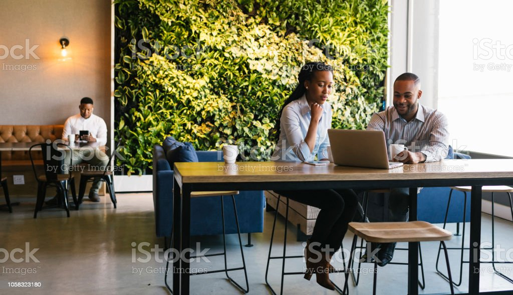 Young adults working in casual office environment stock photo