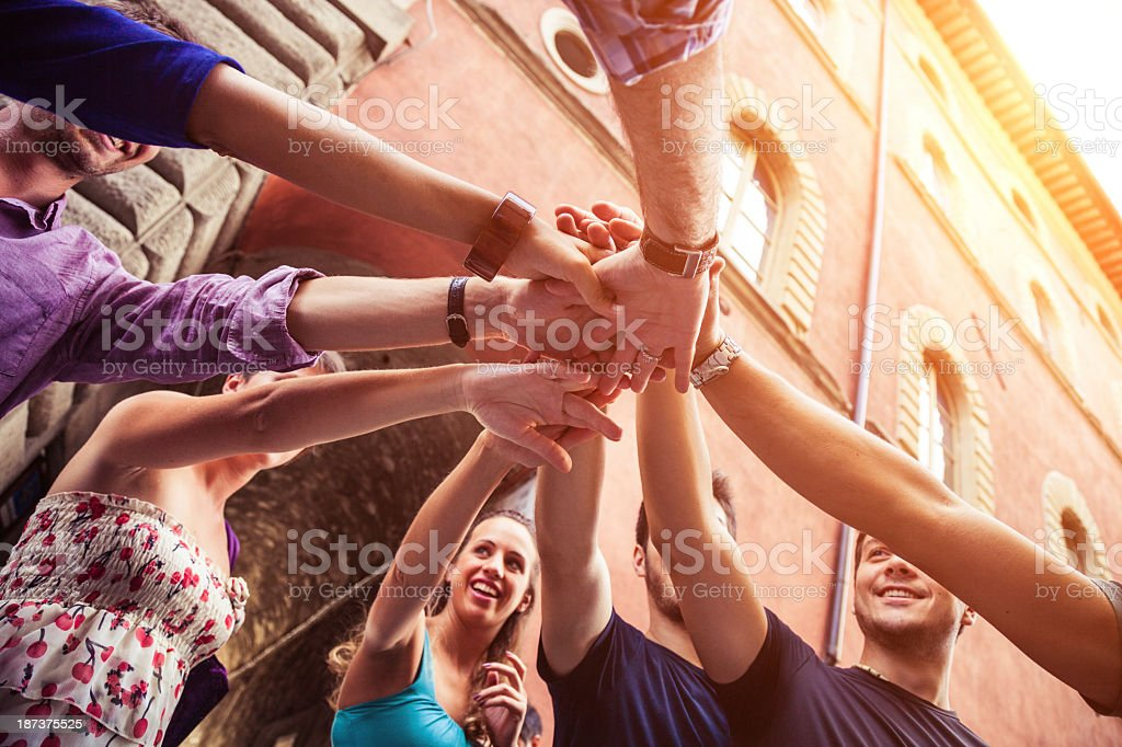 Young adults working together stock photo