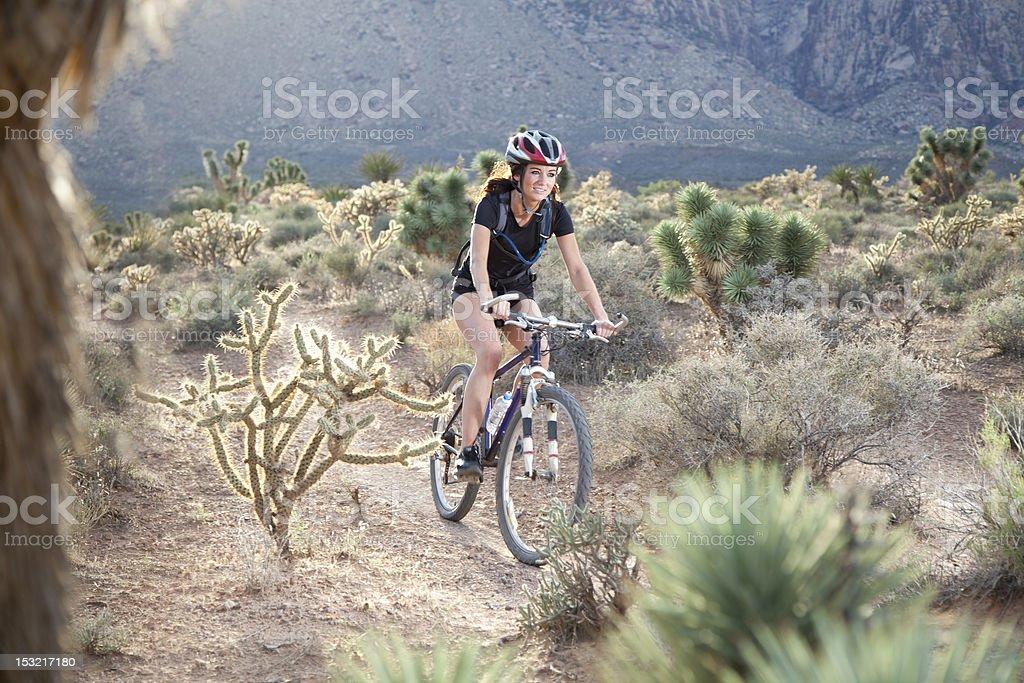 Young Adventurous Woman On Mountain Bike royalty-free stock photo