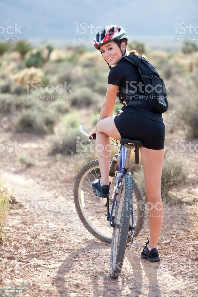 Young Adventurous Woman On Mountain Bike royalty-free stock photo