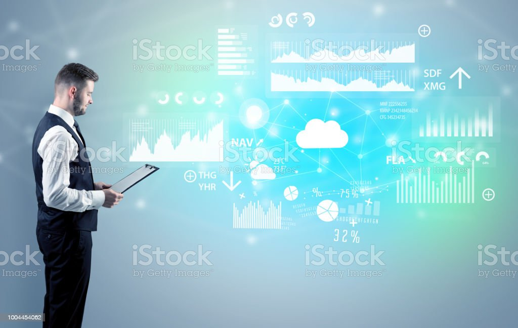 Young adviser with operational reports around stock photo
